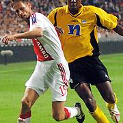 NLD/Amsterdam/20060928 - Voetbal, Uefa Cup voorronde 2006, Ajax - IK Start, Bala Armed Barba in duel met Olaf Lindenbergh