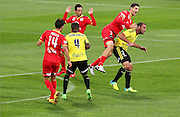 Adelaide United's Iacopo La Rocca climbs high over Phoenix' Emmanuel Muscat during the Round 22 A-League football match - Wellington Phoenix V Adelaide United at Westpac Stadium, Wellington. Saturday 5th March 2016. Copyright Photo.: Grant Down / www.photosport.nz
