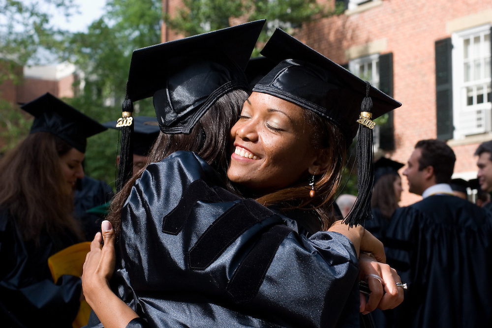 Roxanna Rodriguez, D. O., hugs a fellow graduate before the ceremony.