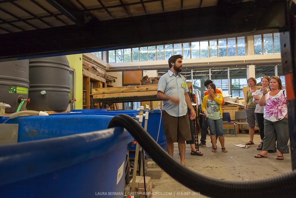 FoodShare's Justin Nadeau explains aqualculture to workshop particpants at  the Field to Table Schools Program's Educators' Workshop at Bendale school.