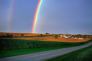 Shortly after a thunderstorm has passed, a double rainbow appears over the lush corn fields between Freeport and Rockford, IL.