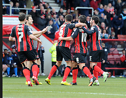 Bournemouth players congratulate Bournemouth's Yann Kermorgant scoring against Huddersfield Town - Photo mandatory by-line: Paul Knight/JMP - Mobile: 07966 386802 - 14/02/2015 - SPORT - Football - Bournemouth - Goldsands Stadium - AFC Bournemouth v Huddersfield Town - Sky Bet Championship