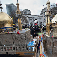 LONDON, ENGLAND - FEBRUARY 07:  Shiite Muslim devotees are seen between two replica models of Mosques while they pray at Marble Arch ahead of the 29th Arbaeen Procession on February 7, 2010 in London, England. Arbaeen occurs 40 days after the day of Ashura, the commemoration of the martyrdom of Imam Husain in Karbala  (Photo by Marco Secchi/Getty Images)
