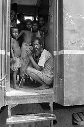 BANGLADESH DINAJPUR DISTRICT DINAJPUR SEP94 - An old homeless man and his children crowd the entrance to an abandoned carriage at Dinajpur station...jre/Photo by Jiri Rezac..© Jiri Rezac 1994