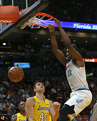 March 1, 2018 - Miami, FL, USA - The Miami Heat's Bam Adebayo dunks against the Los Angeles Lakers' Ivica Zubac (40) during the first quarter at the AmericanAirlines Arena in Miami on Thursday, March 1, 2018. The Lakers won, 131-113. (Credit Image: © David Santiago/TNS via ZUMA Wire)