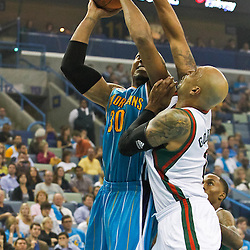 October 27, 2010; New Orleans, LA, USA;  New Orleans Hornets power forward David West (30) shoots over Milwaukee Bucks power forward Drew Gooden (0) during the first quarter at the New Orleans Arena. Mandatory Credit: Derick E. Hingle