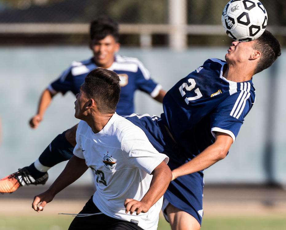 November 4, 2016 - Fullerton, CA - Fullerton College Freshman Midfielder Armando Torres (27) takes a header in a loss to Golden West College 0-2