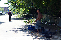 Addicts wonder alongside the train tracks near the herion camp located under the North Second Street overpass, in the Kensington Section of Philadelphia, PA, on July 31, 2017. A large joined operation of Conrail and the City of Philadelphia to clean up the popular open drug area is expected to take 30 days.