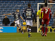 Picture by David Horn/Focus Images Ltd +44 7545 970036<br /> 03/12/2013<br /> Steve Morison of Millwall scores his team's first goal to make it 1-0 during the Sky Bet Championship match at The Den, London.