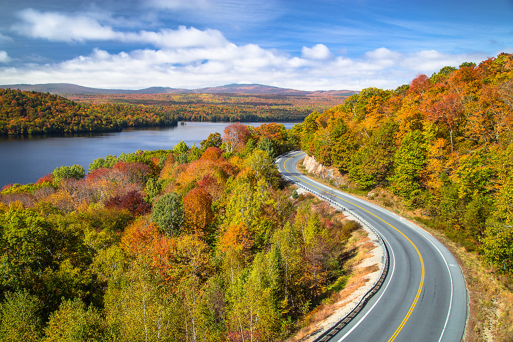 The Old Canada Road Curves around the coloful hills along Wyman Lake in Central Maine