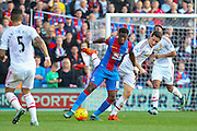 Wilfried Zaha (11) of Crystal Palace shields the ball from Ander Herrera of Manchester United during the Barclays Premier League match between Crystal Palace and Manchester United at Selhurst Park, London, England on 31 October 2015. Photo by Phil Duncan.