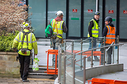 © Licensed to London News Pictures. 31/03/2020. Harrogate UK. Workmen at the the Harrogate Convention Centre in Harrogate this morning that is being turned into a NHS Nightingale hospital in the fight against coronavirus. The Convention Centre is the latest facility to be announced as a chosen site, joining the National Exhibition Centre (NEC) in Birmingham, the Manchester Central Complex, and the ExCeL conference centre in East London, to help deal with the rising number of coronavirus cases.Photo credit: Andrew McCaren/LNP