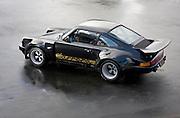 Image of a black sports car hot rod coupe in California, 1974 Porsche 911 RSR Carrera Replica, American Southwest, property released