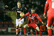 Exeter City forward, on loan from Bournemouth, Jayden Stockley  and York City defender, on loan from Newcastle United, Kyle Cameron challenge for the ball  during the Sky Bet League 2 match between York City and Exeter City at Bootham Crescent, York, England on 16 February 2016. Photo by Simon Davies.