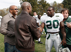 "October 8, 2009; Florham Park, NJ; USA; Floyd ""Money"" Mayweather shakes hands with New York Jets RB Thomas Jones after the New York Jets practice in Florham Park, NJ."