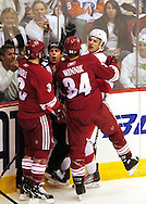 Apr 23, 2010; Glendale, AZ, USA; Phoenix Coyotes defenseman Keith Yandle (3) , Phoenix Coyotes center Daniel Winnik (34) and Detroit Red Wings defenseman Brad Stuart (23) come together in a scrum during the second period of game five in the first round of the 2010 Stanley Cup Playoffs at Jobing.com Arena.  Mandatory Credit: Jennifer Stewart-US PRESSWIRE