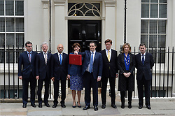 The Chancellor George Osborne poses with the Treasury Ministerial Team outside of No11 Downing street with his red budget box for the 2014 Budget, London, United Kingdom. Wednesday, 19th March 2014. Picture by Ben Stevens / i-Images