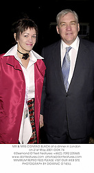 MR & MRS CONRAD BLACK at a dinner in London on 21st May 2001.OOK 74