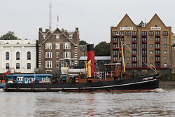 © Licensed to London News Pictures. 19/09/2016. LONDON, UK.  The historic Steam Tug, Portwey making her final journey this autumn on the River Thames, passing Wapping during sunny weather this morning. Steam Tug Portwey is returning to her mooring in West India Dock, where she will remain during the winter months to have her engine stripped down and maintenance work carried out. Steam Tug Portwey is the only twin screw, coal fired steam tug still active in the United Kingdom.  Photo credit: Vickie Flores/LNP