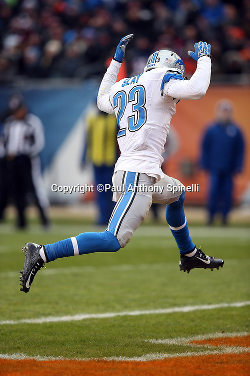 Detroit Lions cornerback Darius Slay (23) leaps in anguish after having an opportunity to intercept a fourth quarter pass in the end zone during the NFL week 17 regular season football game against the Chicago Bears on Sunday, Jan. 3, 2016 in Chicago. The Lions won the game 24-20. (©Paul Anthony Spinelli)