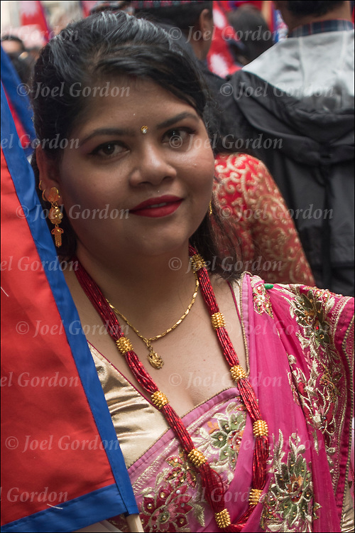 Nepalese ethnic pride head and shoulders portrait of smiling Nepalese woman dressed in regalia and traditional Nepal clothing and gold jewelry in &ldquo;Nepal Day Parade.&rdquo; <br /> <br /> Nepal is a landlocked country in South Asia and occupies an area of 56,136 square miles. Located between China and India, Nepal is known for its majestic Himalayas and is the home of Mount Everest, the highest peak in the world. Nepal is also the birthplace of Lord Buddha. The national capital is Kathmandu.