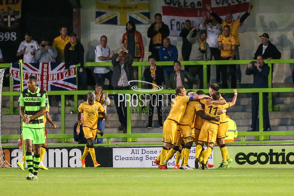 Sutton players celebrate in front of their fans after Sutton United's Nicky Bailey equalises from the penalty spot, 1-1 during the Vanarama National League match between Forest Green Rovers and Sutton United at the New Lawn, Forest Green, United Kingdom on 9 August 2016. Photo by Shane Healey.