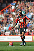 AFC Bournemouth's defender Steve Cook looks to move the ball upfield during the Barclays Premier League match between Bournemouth and Sunderland at the Goldsands Stadium, Bournemouth, England on 19 September 2015. Photo by Mark Davies.