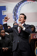 Comedian Stephen Colbert holds a rally with former Republican presidential candidate Herman Cain at the College of Charleston on January 20, 2012 in Charleston, South Carolina. Colbert held the event with Cain, titled Rock Me Like a Herman Cain South Cain-olina Primary Rally, as part of his pseudo-run for president of The United States of South Carolina.