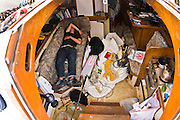 Zac collapses on his bed after being up for nearly 3 days, having to hand steer Intrepid into Port Louis, Mauritius