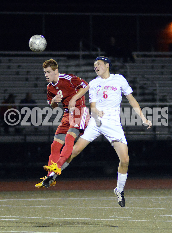 FRANCONIA, PA - NOVEMBER 11: Fleetwood's Austin Young #9 heads the ball as Holy Ghost Prep's Colin O'Hara defends in the first half of the District One Class AA semifinal soccer playoff game at Souderton High School November 11, 2014 in Franconia, Pennsylvania.  (Photo by William Thomas Cain/Cain Images)