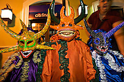 Children costumed revelers called a vejigante in the streets during the Carnaval de Ponce February 21, 2009 in Ponce, Puerto Rico. Vejigantes are a folkloric character representing the devil.