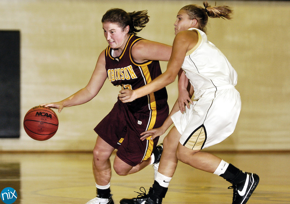 Jay M. Robinson's Joanne Hall drives on Concord's Casey Shue Wednesday night during Robinson's 61-53 win over the Spiders.