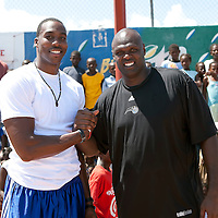 Dwight Howard and Adonal Foyle pose with students during their recent trip to Haiti to promote the Dwight Howard Fund for relief for Haitian families.  Mandatory Credit: Alex Menendez Dwight Howard in Haiti after the 2010 earthquake for the D12 Foundation relief fund.