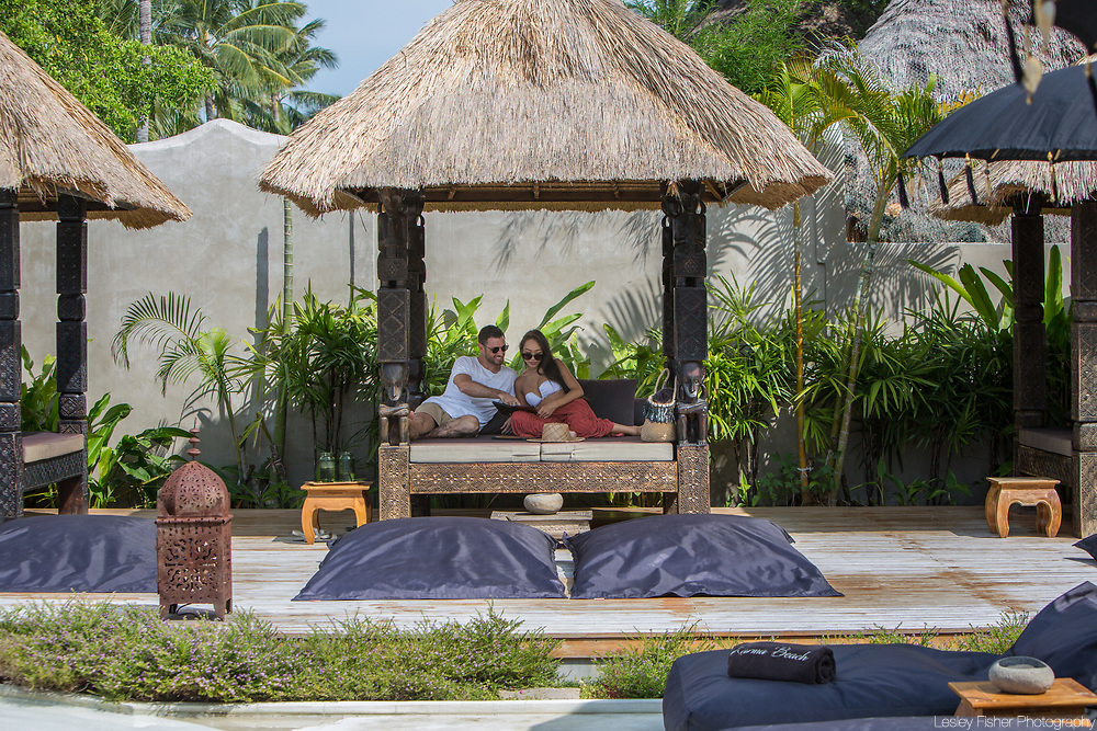 A couple relaxing in the pool Sala at Karma Beach Resort, a unique resort located on Bophut Beach, Koh Samui, Thailand