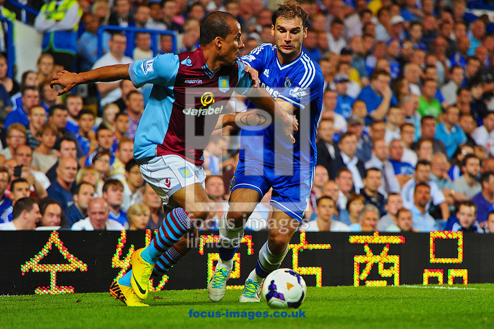 Picture by Ian Wadkins/Focus Images Ltd +44 7877 568959<br /> 21/08/2013<br /> Gabriel Agbonlahor of Aston Villa is challenged by Branislav Ivanović of Chelsea during the Barclays Premier League match at Stamford Bridge, London.