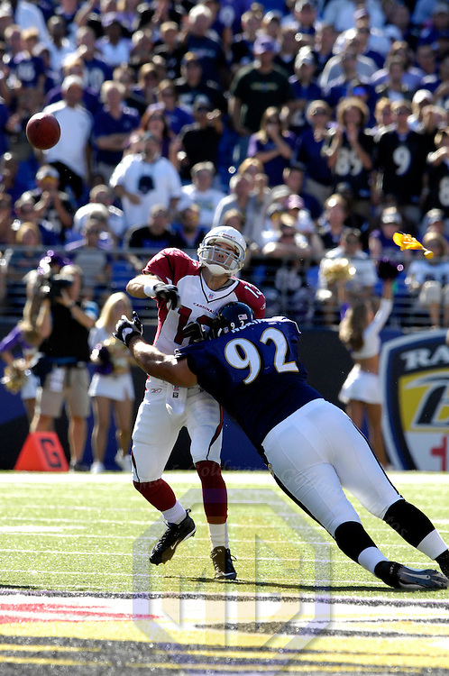 23 September 2007:  Arizona Cardinals quarterback Kurt Warner (13) completes a pass under pressure from Baltimore Ravens defensive tackle Haloti Ngata (92) in the 4th quarter to wide receiver Bryant Johnson for an 18-yard gain.  The Ravens defeated the Cardinals 26-23 on a 46 yard field goal by Matt Stover with no time remaining at M&T Bank Stadium in Baltimore, Md. .