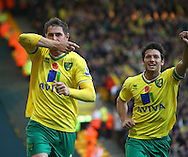 Picture by Paul Chesterton/Focus Images Ltd.  07904 640267.29/10/11.Grant Holt scores his sides equalising goal from the penalty spot and celebrates during the Barclays Premier League match at Carrow Road stadium, Norwich.