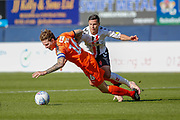 Charlton Athletic midfielder Josh Cullen (24) brings down Luton Town defender Glen Rea (16)  during the EFL Sky Bet League 1 match between Luton Town and Charlton Athletic at Kenilworth Road, Luton, England on 29 September 2018.
