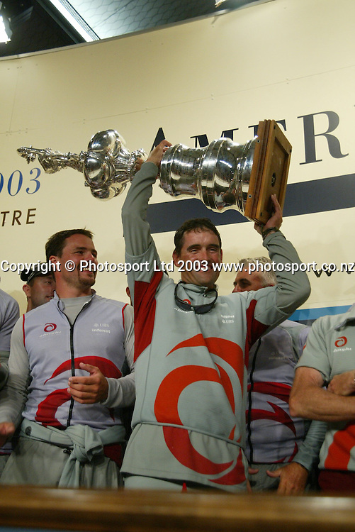 2 March 2003, Americas Cup Final, Post Press Conference, Viaduct Harbour, Auckland, New Zealand.<br />Russell Coutts with crew mates celebrating their victory. <br />Pic: Sandra Teddy/Photosport