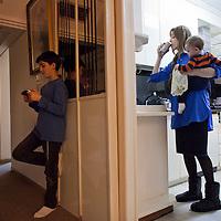 Miri Beillin, an ultra orthodox Jewish stylist and fashion designer, with her children at their house in Bnei Brak