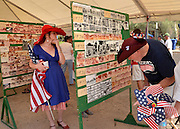 "July 4, 2013:  Celebrants in the Palo Verde Neighborhood participate in the 50th annual Fourth of July parade to celebrate the anniversary of the independence of the United States in Tucson, Arizona, USA.  Deana Radtke, (left), and her father, Dale, look at photos from past parades.  Deana has participated in the parades since she was ""a little girl."""