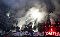 Malmo fans set off flares during the UEFA Europa League round of 32 second leg match at Stamford Bridge, London.