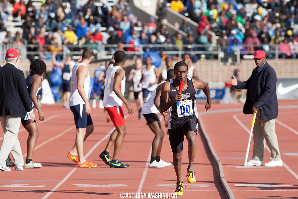 A member of Howard Community College runs competes in the  College Men's 4x400 Heat during the Penn Relays athletic meets on Friday, April 27, 2012 in Philadelphia, PA.