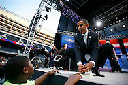Senator Barack Obama (D) of Illinois, signs and autograph during a commercial break at  an AFL-CIO Working Families Presidential Candidates Forum at Soldier Field in Chicago Tuesday evening.
