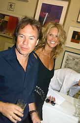 ELLE MACPHERSON and JOHN HITCHCOX at the Royal Academy of Art's SUmmer Party following the official opening of the Summer Exhibition held at the Royal Academy of Art, Burlington House, Piccadilly, London W1 on 7th June 2006.<br /><br />NON EXCLUSIVE - WORLD RIGHTS