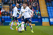 Bolton Wanderers defender Dorian Dervite (4) lays the ball off during the EFL Sky Bet League 1 match between Bolton Wanderers and AFC Wimbledon at the Macron Stadium, Bolton, England on 4 March 2017. Photo by Simon Davies.