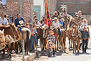 Mexican cowboys pray during Catholic mass at the San Martin de Terreros church during the annual Cabalgata de Cristo Rey pilgrimage January 4, 2017 in Guanajuato, Mexico. Thousands of Mexican cowboys and horse take part in the three-day ride to the mountaintop shrine of Cristo Rey stopping along the way at shrines and churches.