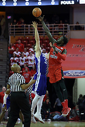 "21 February 2018:  Nick McGlynn and Daouda ""David"" Ndiaye perform the opening jump ball thrown by Zelton Steed during a College mens basketball game between the Drake Bulldogs and Illinois State Redbirds in Redbird Arena, Normal IL"