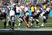 Los Angeles Chargers center Spencer Pulley (73) gets set to snap the ball at the line of scrimmage during the 2017 NFL week 1 preseason football game against the Seattle Seahawks, Sunday, Aug. 13, 2017 in Carson, Calif. The Seahawks won the game 48-17. (©Paul Anthony Spinelli)