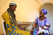 Vaccination team leader N'Faly Samaka talks to a mother about vaccine schedules at the Kita reference health center in the town of Kita, Mali on Monday August 30, 2010.